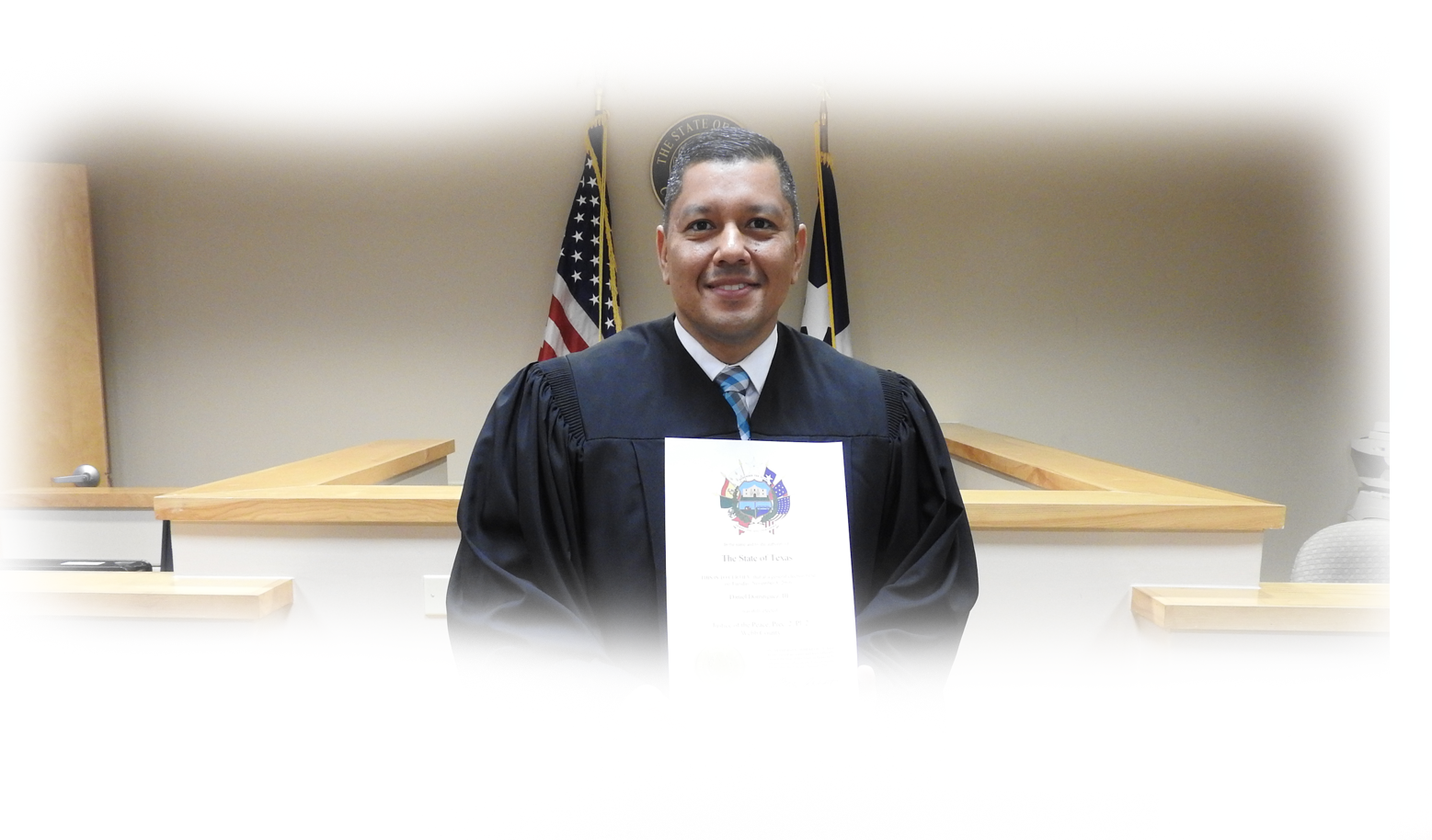 Judge Dominguez in Court Room with award