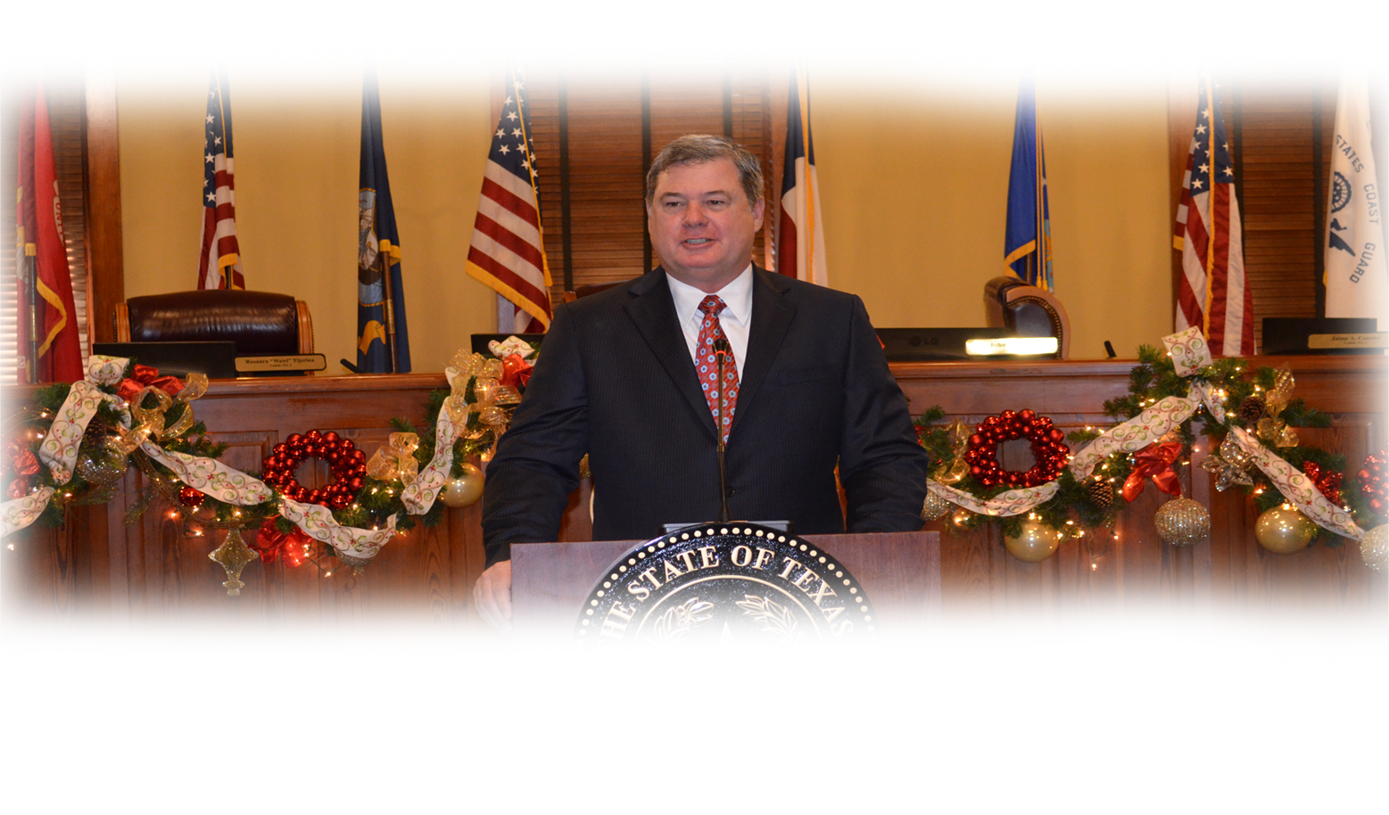 Commissioner John Galo picture at a podium at Commissioner's Court